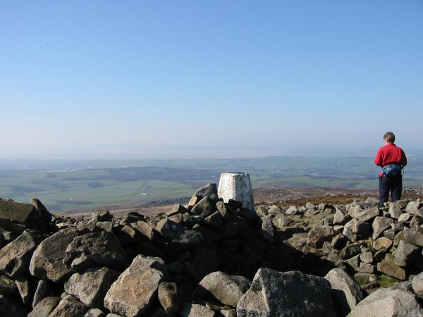 Morecambe Bay with the Lake District lost in the haze from Clough Pike trig point