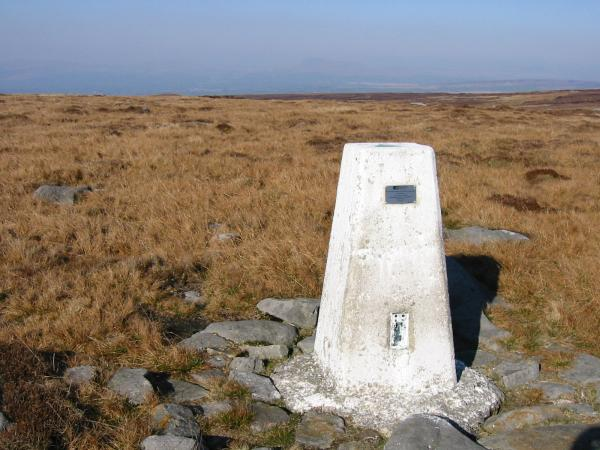 Ingleborough (centre top) just visible in the haze from Ward's Stone 561m trig point.