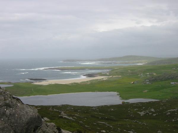 The view northwards up the west coast of Barra from the descent