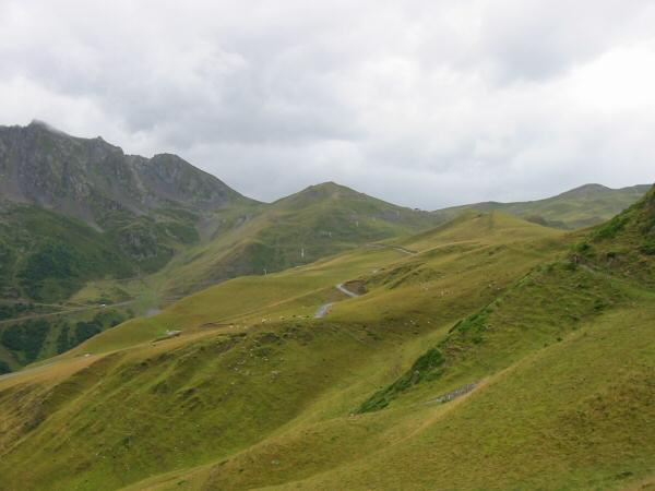 Looking back to the Col de Portet, the right hand side low point on the skyline