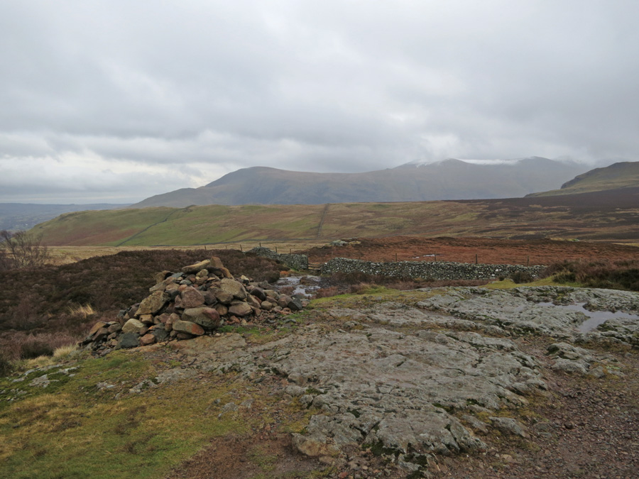 Walla Crag summit cairn, Clough Head and Great Dodd in the distance