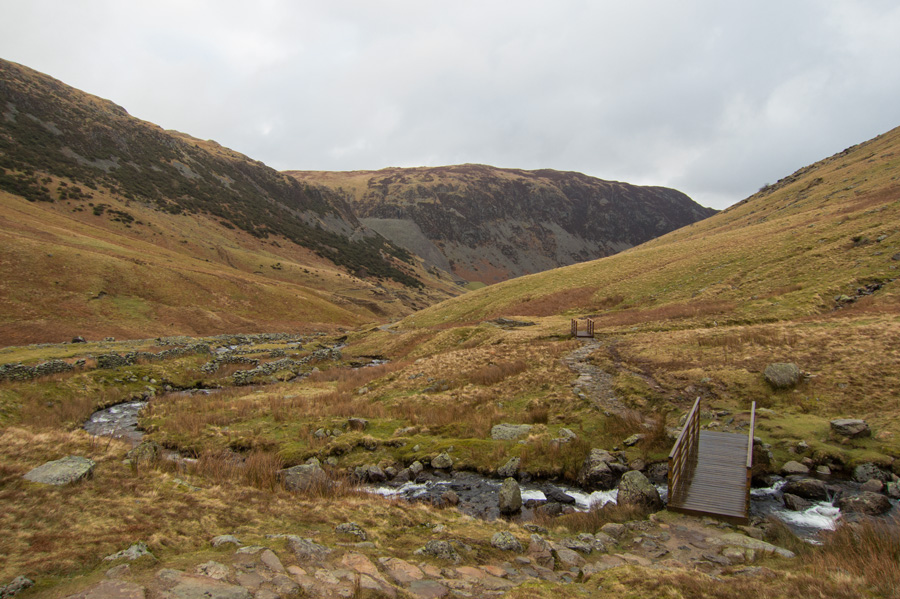 Footbridge across Red Tarn Beck with Sheffield Pike in the distance