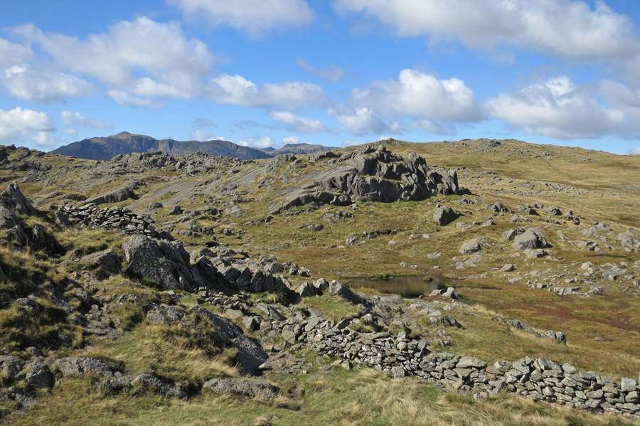 Thunacar Knott on the right with Bowfell in the distance on the left