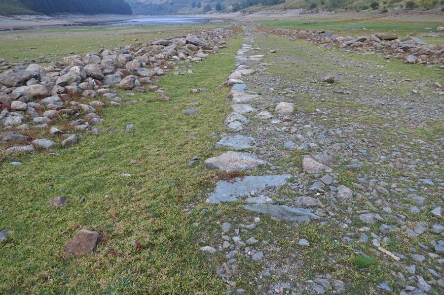 The lack of rain over the Summer months means the reservior is low, exposing the old tracks and walls