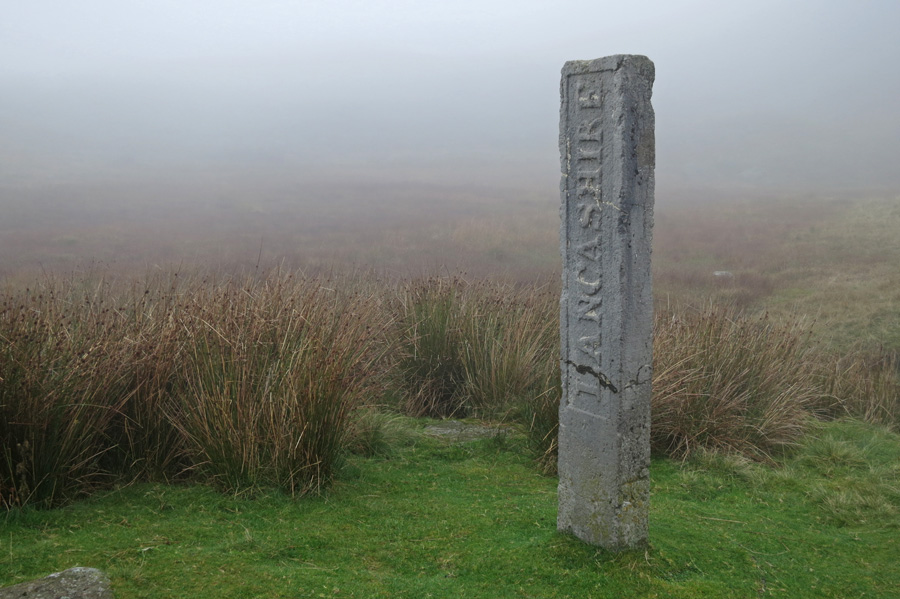 Three Shire Stone at the top of Wrynose Pass