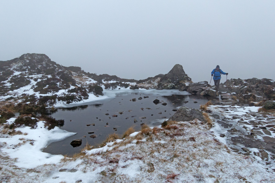 Passing a small unnamed tarn on the ascent