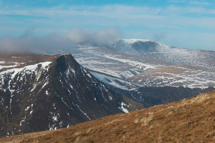 Lonscale Fell's east top and the Skiddaw fells with some snow still on them.