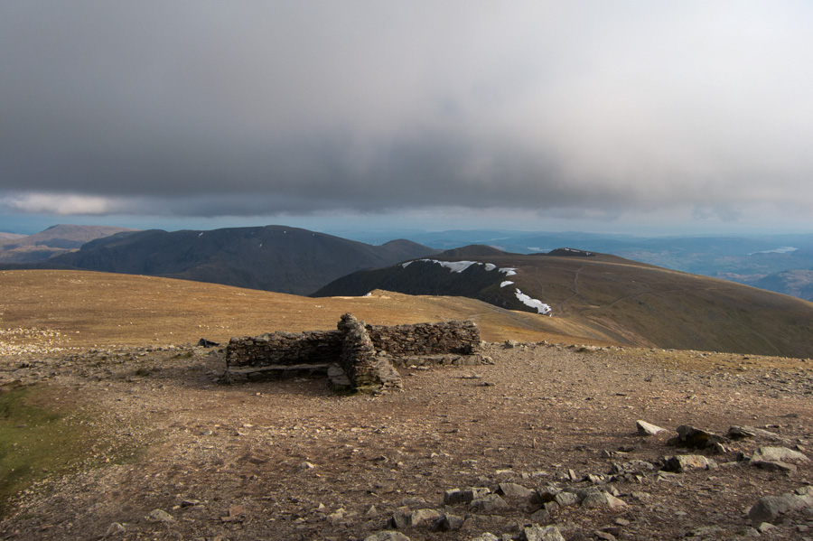 Helvellyn's summit cross shelter and the view south