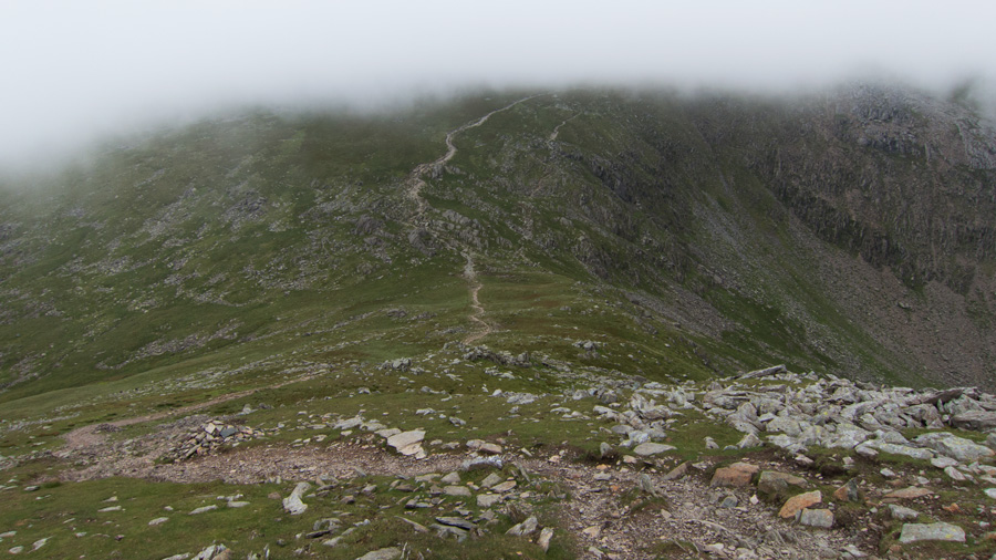 The Old Man of Coniston in cloud on the other side of Goat's Hawse
