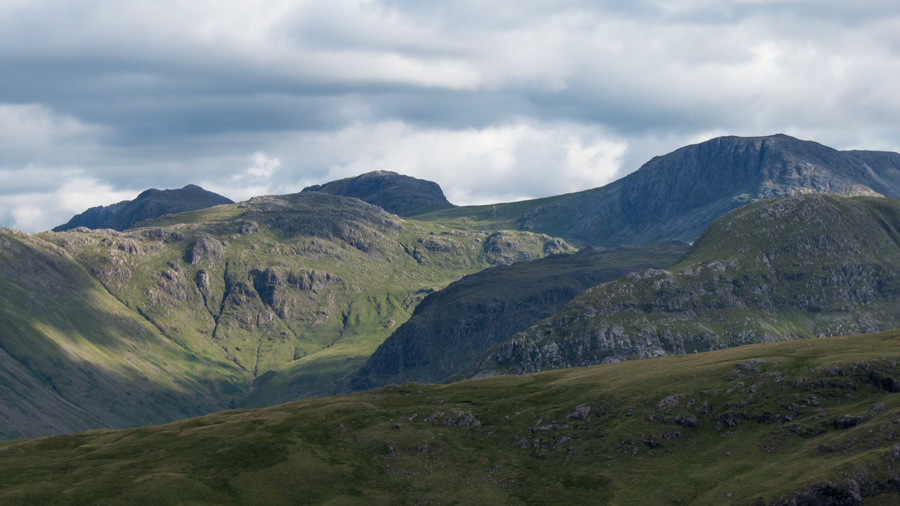 Allen Crags catches the sun with Bowfell behind left and Esk Pike right. Great End behind Base Brown on the right
