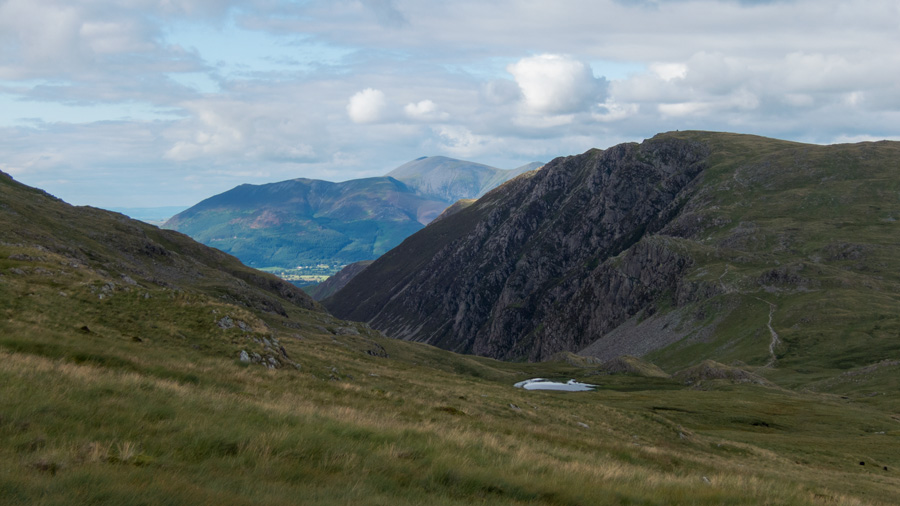 A glimpse of Dalehead Tarn with High Spy behind and Skiddaw in the distance