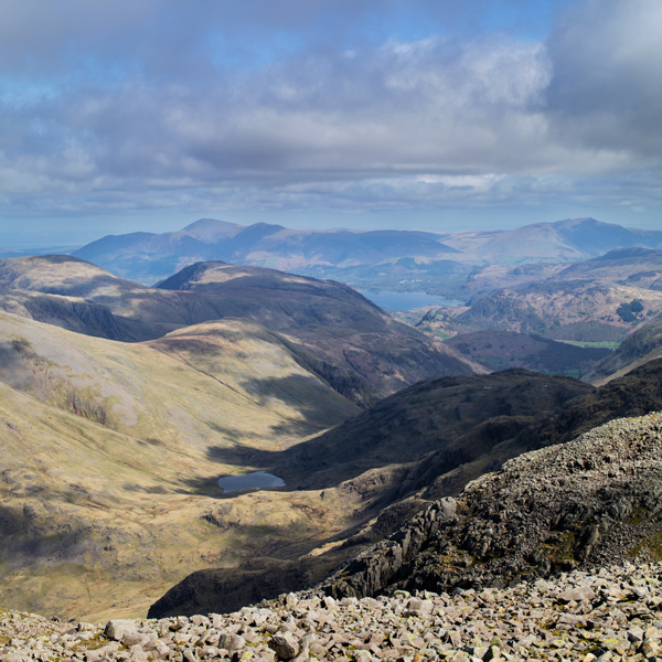 The view north from Scafell Pike's summit with Skiddaw in the distance