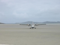 The Twin Otter landing at Barra Airport, Traigh Mhor (21 Jun 2003)